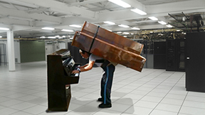 Server lifting done by hand is equivalent to lifting a 400 pound piano.